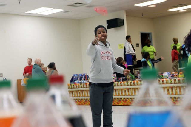 A boy tosses a ring toward bottles of sodas in a game at the Hallelujah Harvest Oct. 31, 2019, at the Frontier Chapel Center. Numerous games were available for children to play and win prizes, or receive tickets that could be redeemed for prizes.