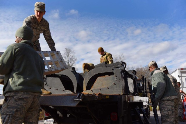 Airmen from the New York Air National Guard's 174th Attack Wing remove equipment from a truck bed as they prepare to remove debris from a blocked road in Herkimer County, N.Y. on Nov. 2, 2019. The Airmen were supporting Operation November Winds, the New York National Guard response to support to citizens of Herkimer County recovering from a major storm that hit the area on October 31-Nov.1.