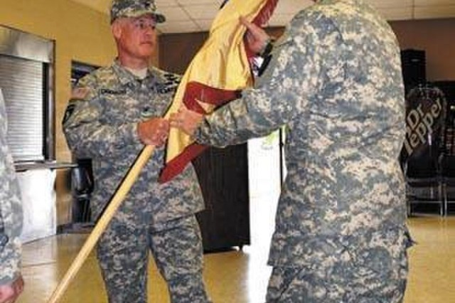 Then-Sgt. Maj. Randall Southerland, right, passes the colors to then-Col. Joseph Creekmore as he takes command of the U.S. Army Materiel Command's Army Reserve Element on Patton Road in Huntsville in May 2013. Southerland and Creekmore are still serving together, as Army civilians, at the U.S. Army Combat Capabilities Development Command Aviation & Missile Center's Systems Simulation, Software and Integration Directorate.
