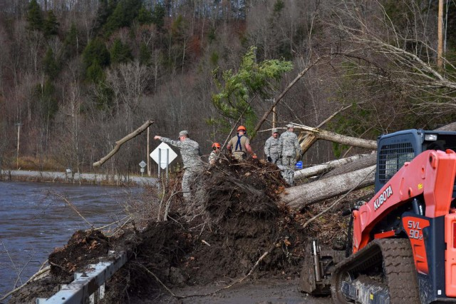 New York Air National Guard Airmen from the 17th Attack Wing removes debris from a blocked road in Herkimer County, N.Y. on Nov. 2, 2019. Heavy winds on October 31/ Nov.1 knocked down trees and rains flooded streams. The Airmen were in support of Operation November Winds, the New York National Guard mission to provide support to citizens of Herkimer County.