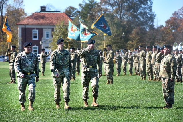 Brig. Gen. Aaron Walter (center) salutes as he troops the line of 100th Training Division for the last time in his Army career.
