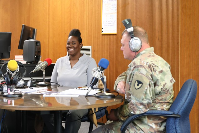 Command Sgt. Maj. Micheal Sutterfield, USAG Bavaria's command sergeant major, and Danell S. Leigh-Triola, a program specialist at ACS, discuss career opportunities available on post during an Armed Forces Network radio interview. Navigating the many events, programs, and career, volunteer and educational opportunities on post will be made easier at the upcoming Career and Volunteer Fair on Nov. 7.