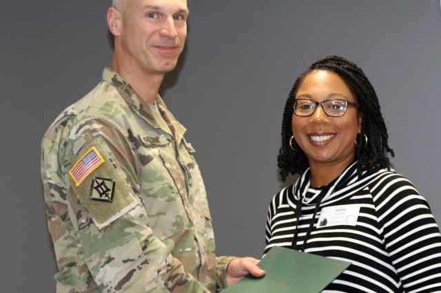 Col. Scott Preston, Commander, Tulsa District U.S. Army Corps of Engineers, presents a certificate to Danielle Morrison, MS navigator with the National MS Society in appreciation of her participation in Tulsa District's lunch and learn series.