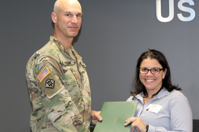 Col. Scott Preston, Commander, Tulsa District U.S. Army Corps of Engineers, presents a certificate to Sunshine Graham, vocational rehabilitation counselor, in appreciation of her participation in Tulsa District's lunch and learn series.