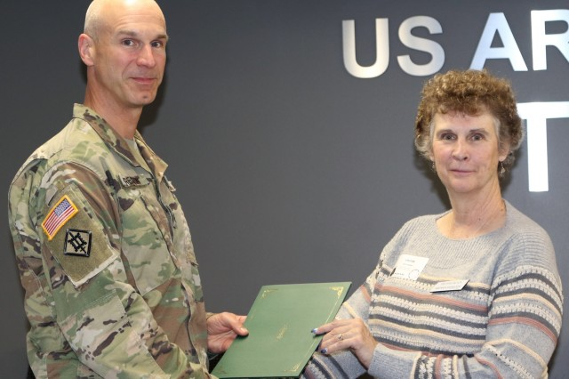 Col. Scott Preston, Commander, Tulsa District U.S. Army Corps of Engineers, presents a certificate to Melanie Black from Parkinson Foundation of Oklahoma, in appreciation of her participation in Tulsa District's lunch and learn series.