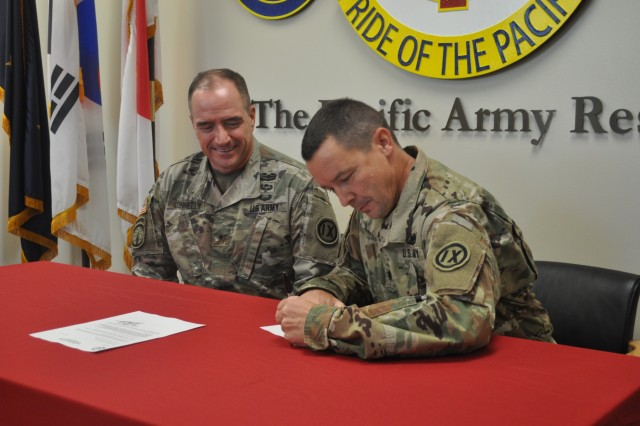Fort Shafter Flats, Hawaii - Lt. Col. William Van Fleet, Detailed Inspector General of the 9th Mission Support Command, signs the Inspector General Oath on Nov. 1, 2019 signifying the importance of the special relationship between the 9th MSC Commanding General and 9th MSC IG. Photos by Maj. Melodie Tafao
