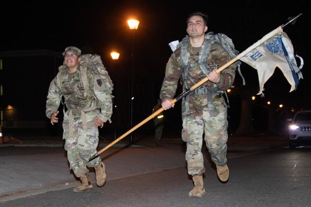 Two U.S. Army Soldiers sprint to the finish line of the Norwegian Foot March Oct. 30, 2019 at Fort Eustis, Virginia. Soldiers were given approximately four hours and 30 minutes to finish the foot march. (U.S. Army photo by Emily Peacock)
