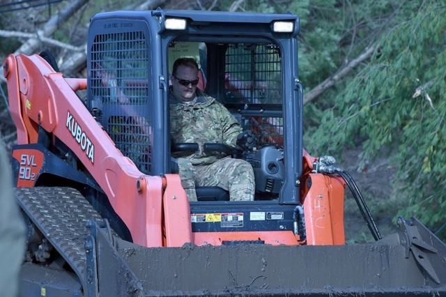 Master Sgt. Dave Taylor assigned to the 174th Attack Wing, Syracuse, New York is driving a Kubota Skid Steer that will help push debris away from roadways. This is in response to the New York National Guard activation Gov. Andrew Cuomo initiated on November 1 for damage caused by rain and winds. (U.S.  (U.S. Air National Guard photo by Airman Tiffany Scofield)