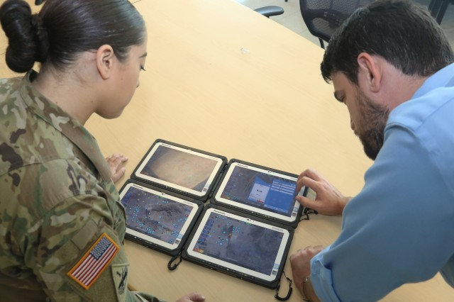 C5ISR Center enlisted adviser Sgt. Keila Peters and computer scientist Chris O'Neill test the Tactical Computing Environment software application at Aberdeen Proving Ground, Md., in October 2019.