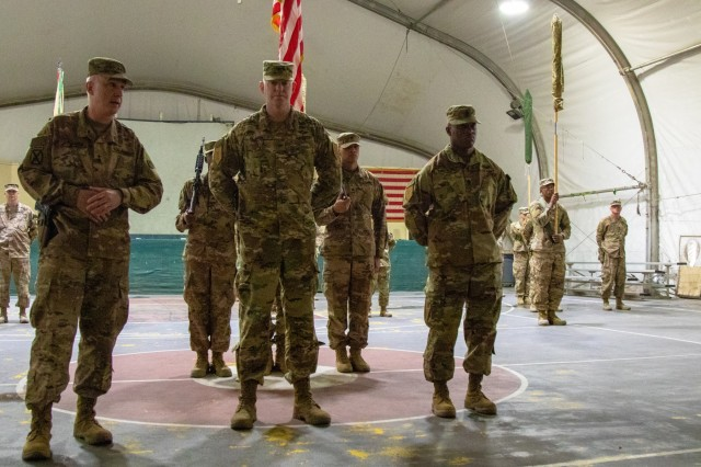 Maj. Gen. John P. Sullivan, 1st Theater Sustainment Command commanding general, speaks before presenting outgoing 1st Infantry Division Resolute Support Sustainment Brigade command team, Col. Brian Olson and Command Sgt. Maj. Dion Lighter, with awards at a transfer of authority ceremony at Bagram Airfield, Afghanistan, Nov. 1, 2019. Under the supervision of the 1st Infantry Division, the brigade was responsible for delivery, storage and distribution of more than 180 million gallons of aviation fuel; management of more than 50 million rounds of ammunition at ammunition supply points around Afghanistan; and 75,000 sorties transported over 120,000 passengers and conducted over 3,000 sling load missions. (U.S. Army photo by Sgt. Sean Harding)