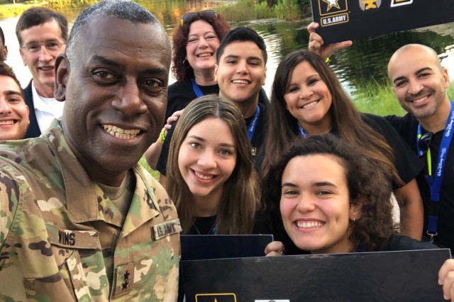 Maj. Gen. Cedric Wins takes a selfie with the 2019 CCDC College Bowl team, during this year's Great Minds in STEM conference.