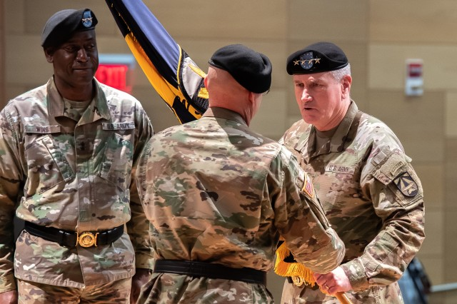 After Maj. Gen. Cedric T. Wins relinquished the CCDC colors, General John M. Murray passes the colors to the incoming CCDC Commanding General, Maj. Gen. John A. George.