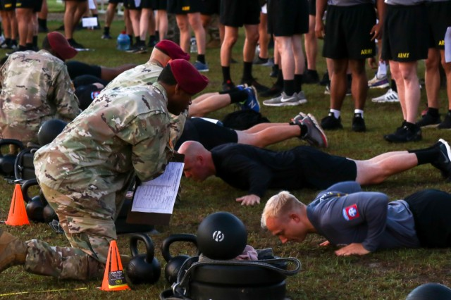 U.S. Army Paratroopers assigned to the 82nd Airborne Division Artillery complete the hand release push-up event of an Army Combat Fitness Test during the Best of the Best Competition on Fort Bragg, North Carolina, Oct. 21, 2019. The DIVARTY held the Best of the Best Competition to distinguish the best section and team in the Division, instill esprit de corps across the fires enterprise, and reward Paratroopers who achieved the highest standards. (U.S. Army photo by Sgt. 1st Class Jason Hull)