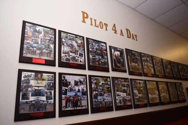 """The """"Pilot 4 a Day"""" wall in the 4th Airlift Squadron on Joint Base Lewis-McChord displays past Pilot for a Day program participants. This wall showcases participants starting from 2010 when the program was revamped by the Air Force Association and the 4th Airlift Squadron."""
