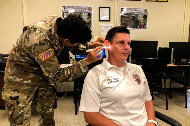 USAG Daegu Directorate of Emergency Services Fire Chief Mike Diehl gets his ear impression made.