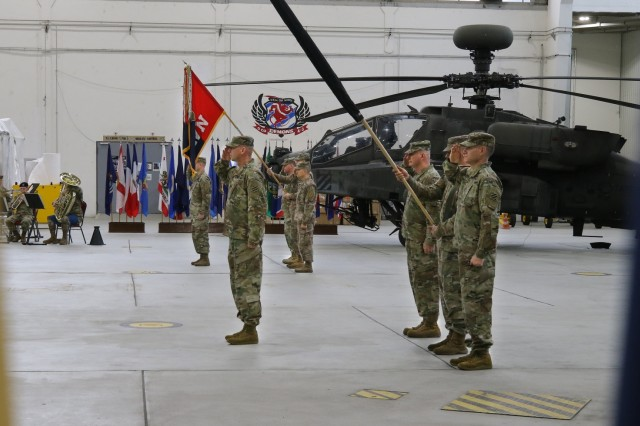 Soldiers from the 1st Combat Aviation Brigade (1st CAB) and the 3rd Combat Aviation Brigade (3rd CAB) present honors during their Transfer of Authority ceremony, Nov. 1, 2019, Illesheim Germany. 3rd CAB is beginning a nine-month rotation in Germany in support of Atlantic Resolve. (U.S. Army photo by Spc. Joseph Knoch)