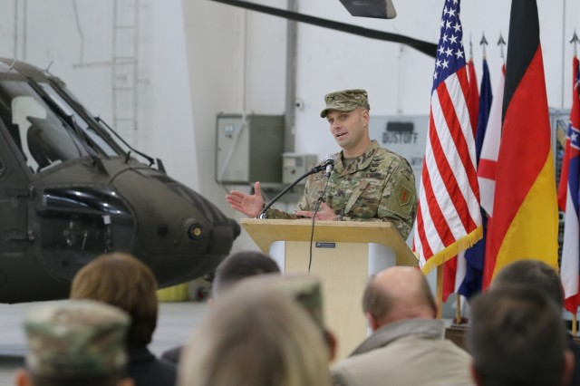 Col. Bryan J. Chivers, Commander of the 1st Combat Aviation Brigade (1st CAB) addresses those in attendance during the Transfer of Authority Ceremony, Nov. 1st, 2019, Illesheim, Germany. 1st CAB is transferring authority over to the 3rd Combat Aviation Brigade from Fort Stewart, Georgia in support of their 9-month rotation in Europe for Atlantic Resolve(U.S. Army photo by Spc. Joseph Knoch)