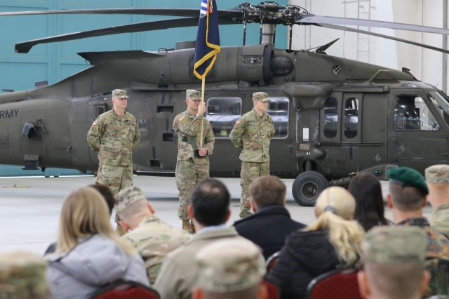 Soldiers with the 3rd Combat Aviation Brigade stand with their newly uncased colors during their Transfer of Authority ceremony, Nov. 1, 2019, Illesheim, Germany. 3rd CAB is currently deployed to Illesheim in support of Atlantic Resolve over the next nine months. (U.S. Army photo by Spc. Joseph Knoch)