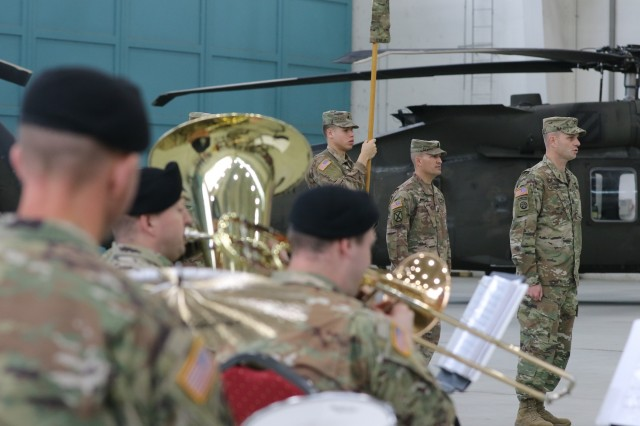 Soldiers in the U.S. Army Europe Band play the Army Song during the closing of the 1st Combat Aviation Brigade (1st CAB) to 3rd Combat Aviation Brigade (3rd CAB) Transfer of Authority (TOA) ceremony, Nov. 1, 2019, Illesheim, Germany. This TOA marks the end of a nine-month rotation for 1st CAB and the beginning of a nine-month rotation for 3rd CAB in support of Atlantic Resolve. (U.S. Army photo by Spc. Joseph Knoch)
