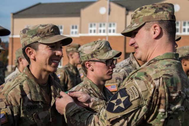 "Lt. Col. Edward Witherell, battalion commander of 2nd Battalion, 1st Infantry Regiment, pins an Army Commendation Medal on 2nd Lt. Elena Chavez, an infantry officer from Kansas City, Mo., assigned to Charlie Company, 1st Battalion, 17th Infantry Regiment, 2nd Stryker Brigade Combat Team, 2nd Infantry Division, during an Expert Infantryman Badge award ceremony at Joint Base Lewis-McChord, Wash., Oct. 31, 2019. Chavez earned the medal by being one of only 59 EIB candidates to earn the title of ""True Blue"" - having completed all 34 tasks with a perfect score throughout the testing."