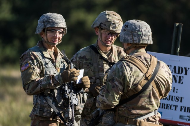 "2nd Lt. Elena Chavez, an infantry officer from Kansas City, Mo., assigned to Charlie Company, 1st Battalion, 17th Infantry Regiment, 2nd Stryker Brigade Combat Team, 2nd Infantry Division, takes a moment with squad mates for one final review before the Expert Infantryman Badge adjust indirect fire lane at Joint Base Lewis-McChord, Wash., Oct. 28, 2019. ""We knew the tasks, we just had to not rush through it,"" Chavez said. ""You train for an entire month, so you don't want to mess it up in the final hours. If you need to, stay out there and practice a couple extra reps to gain a little confidence and go in."""