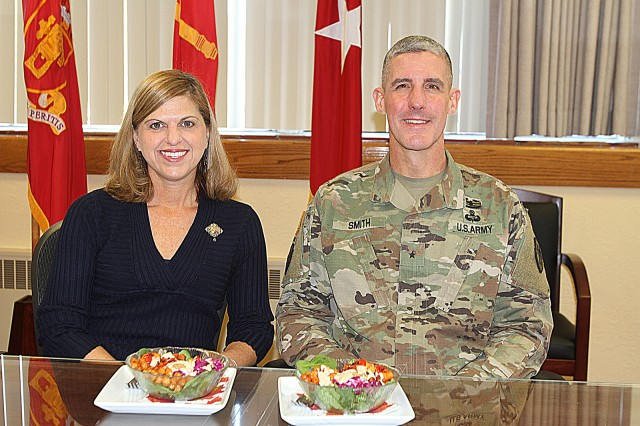 Lynn and Brig. Gen. Steve Smith, Field Artillery School commandant and chief of FA, sit down to one of their power bowls of plants they have for lunch in the general's office. The couple have eaten a plant-based diet for five years now with the general noting an improvement in strength and conditioning.
