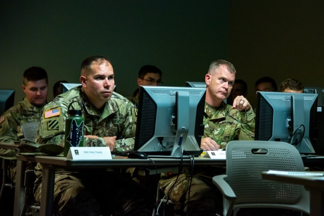 Officers and Noncommissioned Officers from Joint Force Headquarters-National Capital Region and the U.S. Army Military District of Washington participate in classroom instruction during the Company Commander and First Sergeant Course (CCFSC) on Joint Base Myer-Henderson Hall, Virginia, October 29, 2019. The week-long training event was dedicated to developing leadership skills through physical training, classroom instruction, and mentorship by senior leaders.