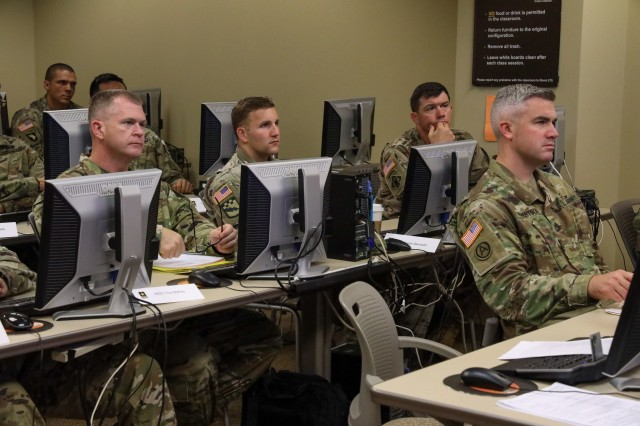 Officers and Noncommissioned Officers from Joint Force Headquarters-National Capital Region and the U.S. Army Military District of Washington participate in classroom instruction during the Company Commander and First Sergeant Course (CCFSC) on Joint Base Myer-Henderson Hall, Virginia, October 31, 2019. The week-long training event was dedicated to developing leadership skills through physical training, classroom instruction, and mentorship by senior leaders.