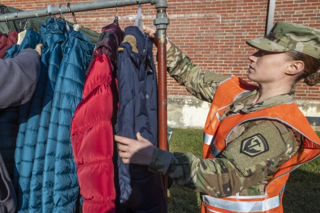 U.S. Army Pvt. Jennifer Michele, 328th Military Police Company, New Jersey Army National Guard, arranges donated winter coats during the Sgt. 1st Class Robert H. Yancey Sr. Stand Down at the National Guard Armory in Cherry Hill, N.J., Sept. 27, 2019. New Jersey National Guard Soldiers and Airmen cooked meals and provided medical assistance at the Stand Down where 187 homeless veterans were provided with access to healthcare, mental health screening, substance abuse counseling, social services - food stamps and unemployment, legal services, religious counseling, a hot meal, a haircut, and winter clothing.
