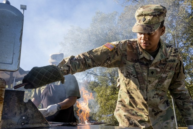 U.S. Army Spc. Janerah W. Glaze, 253rd Transportation Company, New Jersey Army National Guard, grills hamburgers during the Sgt. 1st Class Robert H. Yancey Sr. Stand Down at the National Guard Armory in Cherry Hill, N.J., Sept. 27, 2019. New Jersey National Guard Soldiers and Airmen cooked meals and provided medical assistance at the Stand Down where 187 homeless veterans were provided with access to healthcare, mental health screening, substance abuse counseling, and social services.