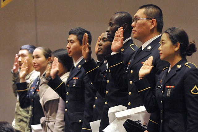 United States service members swear an oath of allegiance to the United States during a naturalization ceremony inside the Club at McChord Field on Joint Base Lewis-McChord in 2018. JBLM has hosted the ceremony for 11 years and will welcome 15 new Americans Nov. 7.