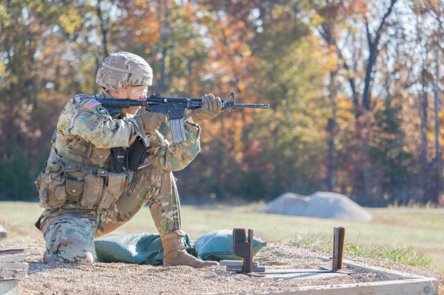 Cadet Taylor Love of Wheaton College, Illinois, aims at a target in the kneeling position during the M4 rifle qualification event at the Blackhawk Ranger Challenge Nov. 1.