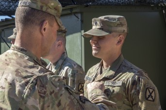10th Mountain CG promotes Soldiers during training exercise