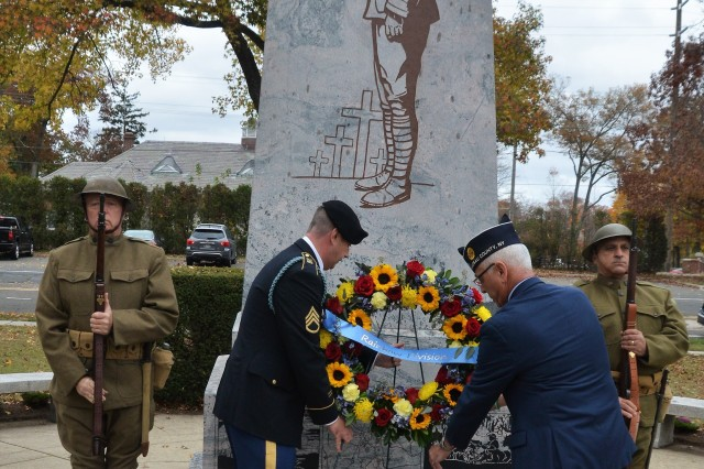 Retired Brig. Gen. Patrick Alesia, president of the 42nd Rainbow Division Association, joins Staff Sgt. Colin Stewart, a Soldier in the New York Army National Guard's 1st Battalion, 69th Infantry, in placing a wreath at the 42nd Infantry Division memorial in Garden City, N.Y., on Nov. 8, 2018. The monument marks the location of Camp Mills, where the 42nd Division, now a part of the New York National Guard, was organized in 1917. A wreath will be placed at the monument once again on Nov. 9, 2019.