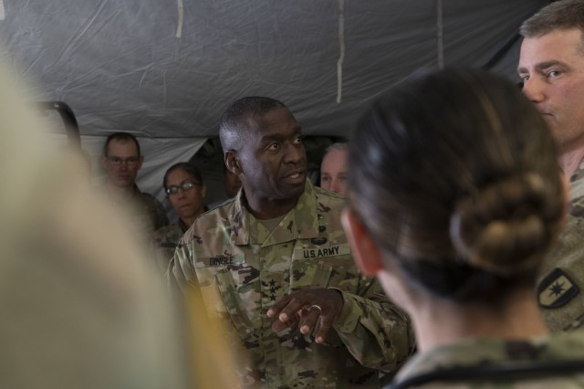 Lt. Gen. R. Scott Dingle, the Surgeon General of the U.S. Army, talks to the medical professionals in the emergency medical tent of the field hospital at Sierra Army Depot, California during the United States Forces Command Medical Emergency Deployment Readiness Exercise Distinguished Visitor Day, Nov. 4, 2019. Dingle and other distinguished visitors received a tour of the field hospital, the exercise control tent, the Effects & Enablers facility as well as a C-17 used for aeromedical evacuations.