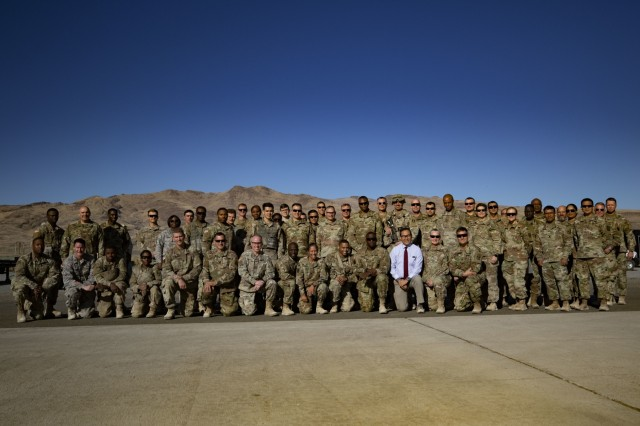 Lt. Gen. R. Scott Dingle, the Surgeon General of the U.S. Army, poses for a picture with Soldiers, Airmen and civilians at Amedee Army Airfield, California during the United States Forces Command Medical Emergency Deployment Readiness Exercise Distinguished Visitor Day, Nov. 4, 2019. Dingle and other distinguished visitors received a tour of the field hospital, the exercise control tent, the Effects & Enablers facility as well as a C-17 used for aeromedical evacuations.