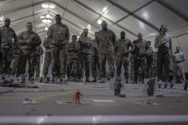Lt. Gen. R. Scott Dingle, the Surgeon General of the U.S. Army, receives a sand table briefing in the exercise control tent at Sierra Army Depot, California, during the United States Forces Command Medical Emergency Deployment Readiness Exercise Distinguished Visitor Day, Nov. 4, 2019. Dingle and other distinguished visitors received a tour of the field hospital, the exercise control tent, the Effects & Enablers facility as well as a C-17 used for aeromedical evacuations.
