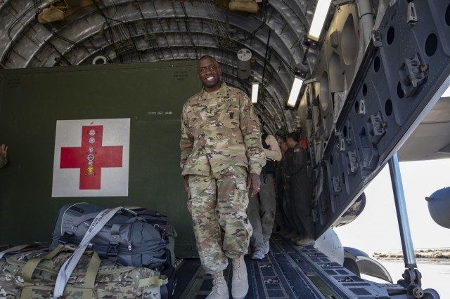 Lt. Gen. R. Scott Dingle, the Surgeon General of the U.S. Army, exits a C-17 used for aeromedical evacuations at Amedee Army Airfield, California, during the United States Forces Command Medical Emergency Deployment Readiness Exercise Distinguished Visitor Day, Nov. 4, 2019. Dingle and other distinguished visitors received a tour of the field hospital, the exercise control tent, the Effects & Enablers facility as well as a C-17 used for aeromedical evacuations.