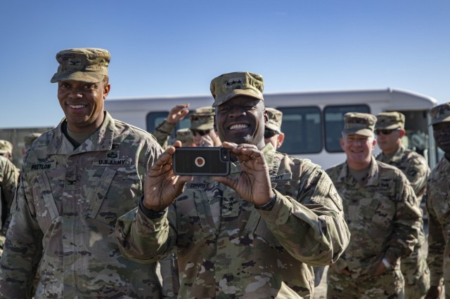 Lt. Gen. R. Scott Dingle, the Surgeon General of the U.S. Army, takes a photo of the field hospital at Sierra Army Depot, California, during the United States Forces Command Medical Emergency Deployment Readiness Exercise Distinguished Visitor Day, Nov. 4, 2019. Dingle and other distinguished visitors received a tour of the field hospital, the exercise control tent, the Effects & Enablers facility as well as a C-17 used for aeromedical evacuations.