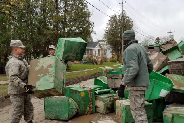 Airmen assigned to the New York Air National Guard's 109th Airlift Wing clear debris from Whitesboro, N.Y. on Nov. 4, 2019, as part of the New York National Guard response to heavy rains and wind which struck Herkimer County on Halloween night. The New York National Guard deployed more than 200 Soldiers and Airmen at the direction of Gov. Andrew M. Cuomo to help local residents recover.