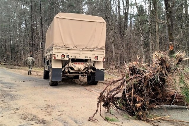 Soldiers assigned to the New York Army National Guard's 3rd Battalion 142nd Aviation remove debris from a road in Herkimer County on Nov. 2, 2019. The battalion deployed a general-purpose response force to the county as part of the 200 Soldiers and Airmen the New York National Guard deployed on the orders of Gov. Andrew M. Cuomo to aid the county in recovery from a major storm that hit on the night of October 31-November 1.