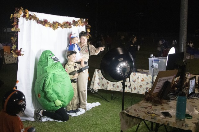 Fort Jackson Soldiers, civilians, residents and their Families enjoy a night of dressing up during the annual Child and Youth Services Fall Festival Oct. 25 at the CYS Sports Field. Families enjoyed candy, free swag, carnival-style games, crafts and bounce houses. The festival moved to the outdoor venue this year to offer attendees more activities and made attending the haunted house more convenient. This year a hay maze was introduced for the first time. Drawings were held for $100 and $50 gift cards as well as awards for best costume and best dance moves. Families could remember the evening by posing for photos with props and take home a copy of the photos as keepsakes.