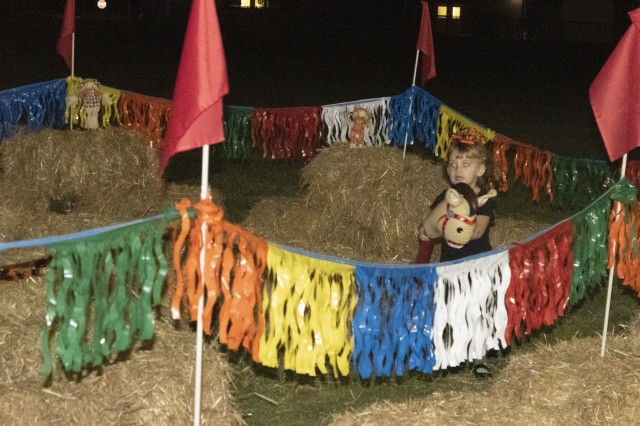 A child explores a hay maze with an inflatable hobbyhorse during this year's Child and Youth Services Fall Festival. The festival moved outdoors this year to expand the event and introduce new activities such as the hay maze.