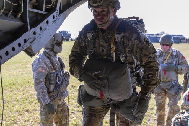 Lt. Col. Ted Hanger, battalion commander, boards a CH-47 Chinook helicopter for his first airborne jump in more than a decade. The Nebraska Army National Guard's newly activated 2nd Battalion, 134th Infantry Regiment conducted its first airborne training exercise, Nov. 2, at the Husker Drop Zone near Yutan, Nebraska.