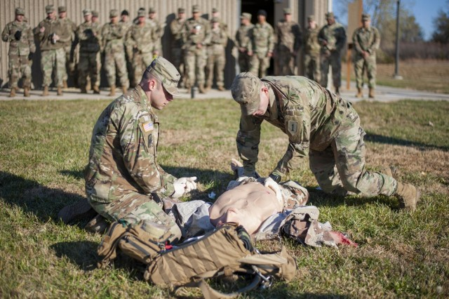 Staff Sgt. Steven Simmons, a flight medic attached to 1st Combat Aviation Brigade, 1st Infantry Division and Cpl. Austin T. Davison, a combat medic, attached to 2nd Armored Brigade Combat Team, 1st Infantry Division, demonstrate different life saving tactics on the Tactical Combat Casualty Care Exportable, November 7, 2019, on Fort Riley, Kansas. A group of combat medics watched as both Simmons and Davison discussed the capabilities of the TC3X. (U.S. Army photo by Spc. Joshua Oh, 19th Public Affairs Detachment)