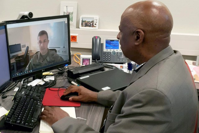 James White, a Health System Specialist with Regional Health Command Europe, uses video conferencing to discuss periodic health assessments with Sgt. 1st Class Todd Hall, the noncomssioned officer in charge of Virtual Health Europe. (Courtesy photo)