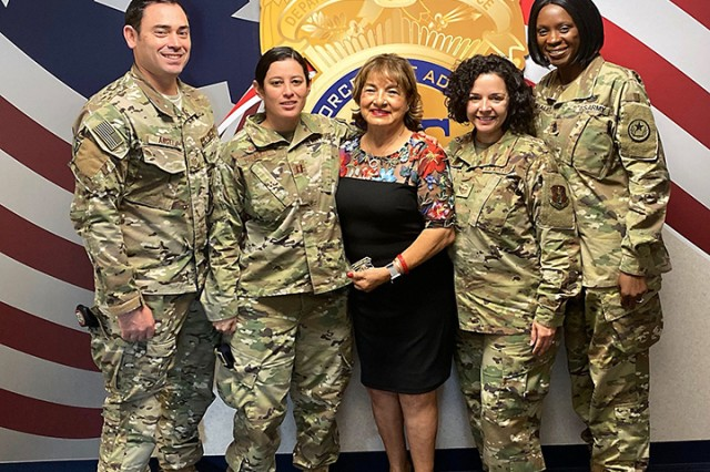Mika Camarena, the wife of fallen DEA special agent Enrique Camarena, poses with Texas National Guard Joint Counterdrug Task Force members at an event in Dallas in support of Red Ribbon Week.