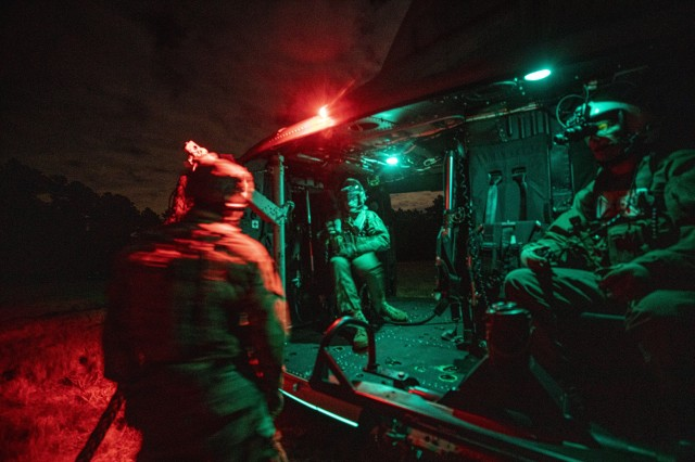 Marine Corps Reserve UH-1Y Venom helicopter crew chiefs with Marine Light Attack Helicopter Squadron 773 get ready for fast rope insertion training with special warfare airmen assigned to the New Jersey Air National Guard's 227th Air Support Operations Squadron on Joint Base McGuire-Dix-Lakehurst, N.J., Oct. 10, 2019.
