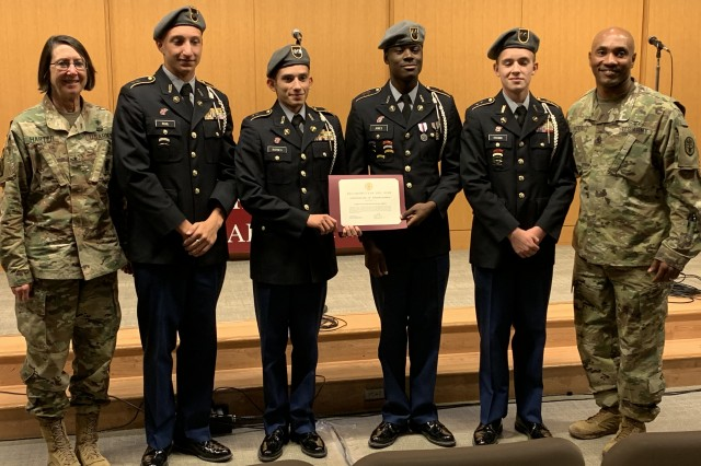 BAMC Commanding General Brig. Gen. Wendy Harter and Command Sgt. Maj. Thomas Oates present a certificate of appreciation to the Wagner High School Junior ROTC Color Guard during the Veterans Day ceremony at Brooke Army Medical Center, Nov. 1, 2019.
