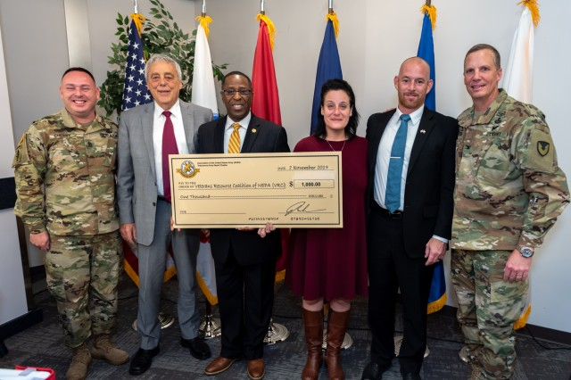 Kelvin Spencer, president of the Tobyhanna Chapter of the Association of the United States Army (AUSA), presented Sandra Connolly, president of the Veterans Resource Coalition of Northeastern Pennsylvania, with a donation to her organization on behalf of the AUSA.